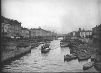 Barges on the Fontanka River near Semenovsky Bridge. Photo by Y. V. Steinberg. 1900s.